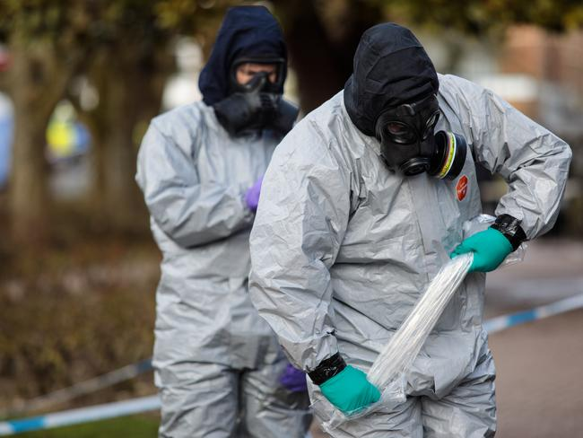 Police officers in protective suits and masks work near the scene where former double-agent Sergei Skripal and his daughter, Yulia were discovered. Picture: Getty