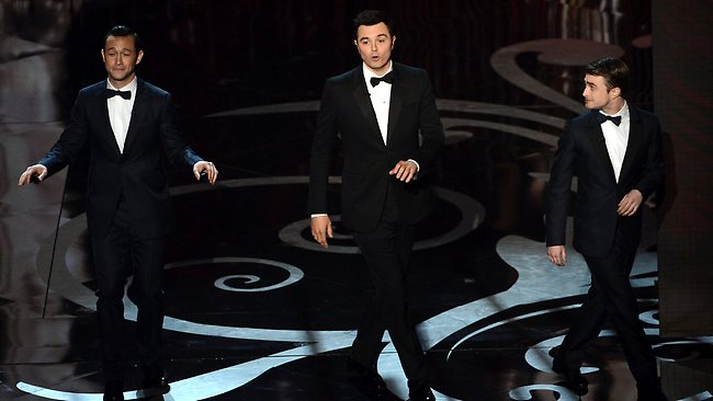 Actor Joseph Gordon-Levitt, host Seth MacFarlane and actor Daniel Radcliffe dance onstage during the Oscars. Picture: Getty
