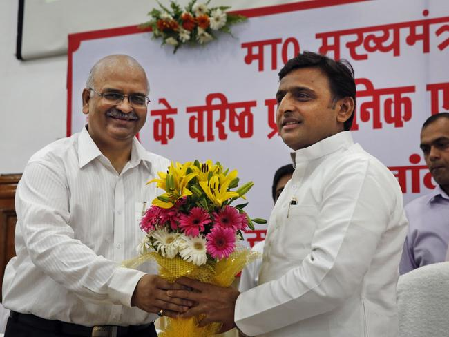 "Facing criticism over the law and order situation following a series of rapes in his state, Uttar Pradesh state Chief Minister Akhilesh Yadav (right) held a meeting of top officials saying the kind of work expected from the administration and police in the district was ""not being done,"" according to local reports."