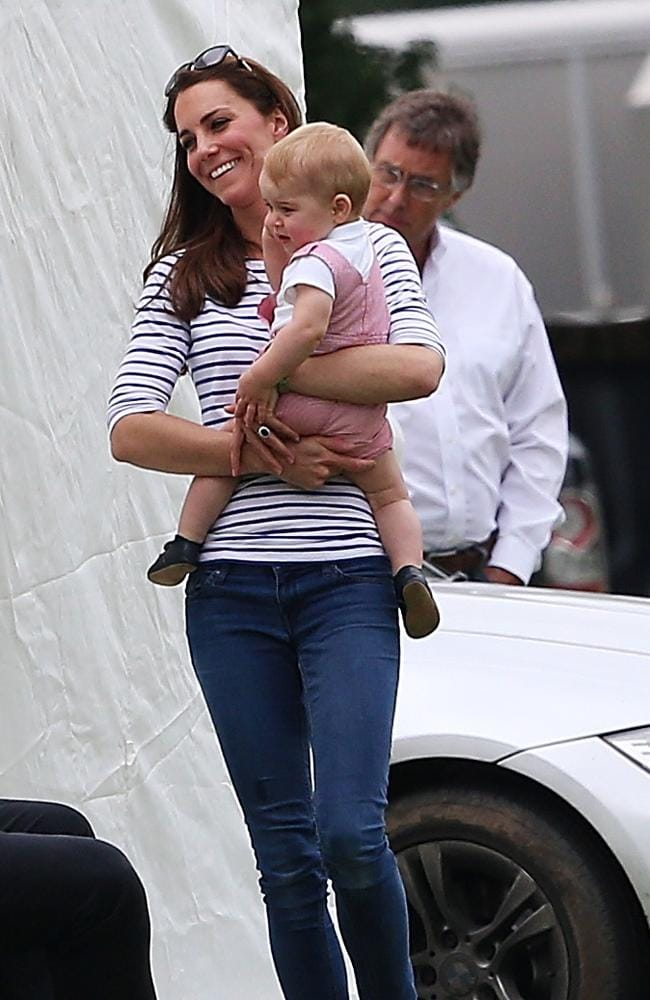 Catherine went casual at the charity match in blue jeans and flats with a blue and white striped top.