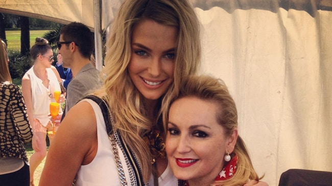 Jennifer Hawkins and Melissa Hoyer catch up in the Range Rover tent at the Paspaley Polo in the Park.