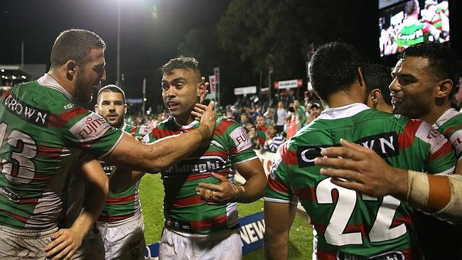 Nathan Merritt celebrates scoring a try with team mate Sam Burgess.