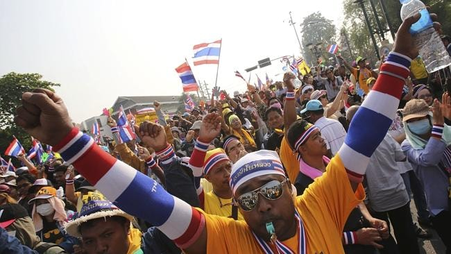Protests ... Anti-government demonstrators march to government house in Bangkok. Pic: Sakchai Lalit.