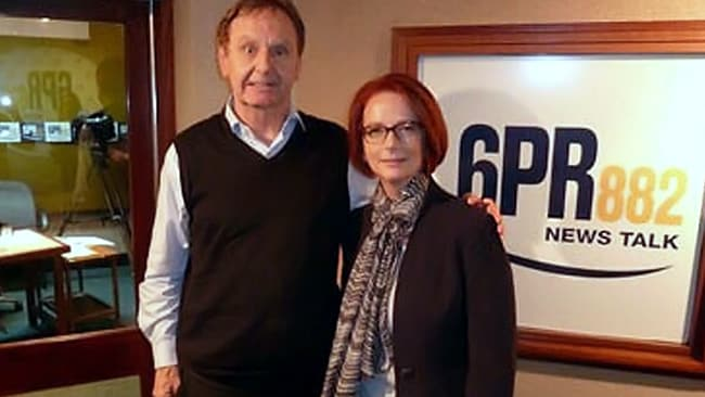 Howard Sattler looking uncomfortable posing with the Prime Minister after his on-air jibe about her partner's sexuality. PICTURE: Twitter (6PR)