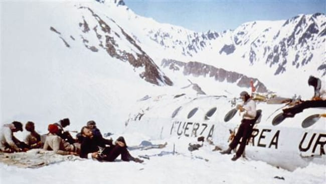 Survivors by the wreckage in the Andes.