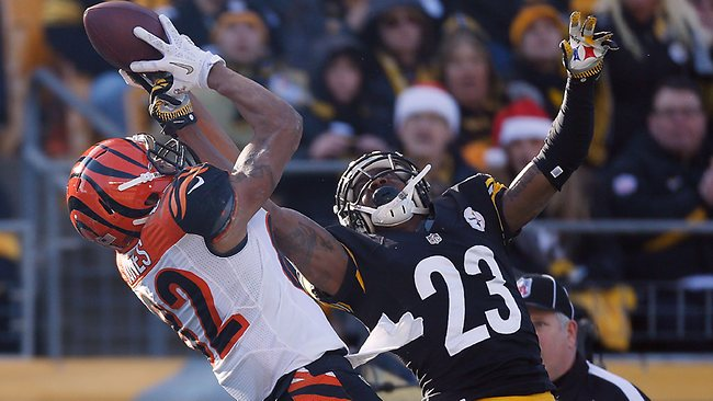 Marvin Jones #82 of the Cincinnati Bengals tries to make a second quarter catch but its broken up by Keenan Lewis #23 of the Pittsburgh Steelers at Heinz Field on December 23, 2012 in Pittsburgh, Pennsylvania. Gregory Shamus/Getty Images/AFP