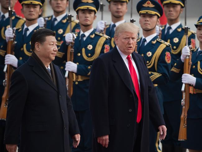 "Donald Trump with Xi Jinping reportedly refers to China as a ""strategic competitor"". in a new national security document. Picture: AFP/Nicolas Asfouri"