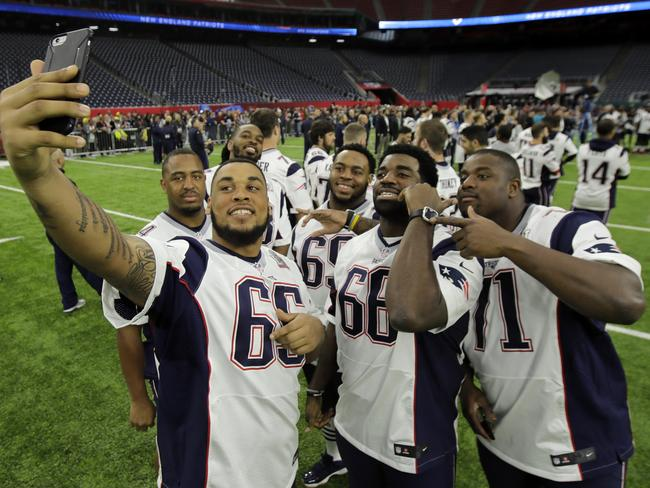 New England Patriots players take a selfie during a walk through at NRG Stadium.
