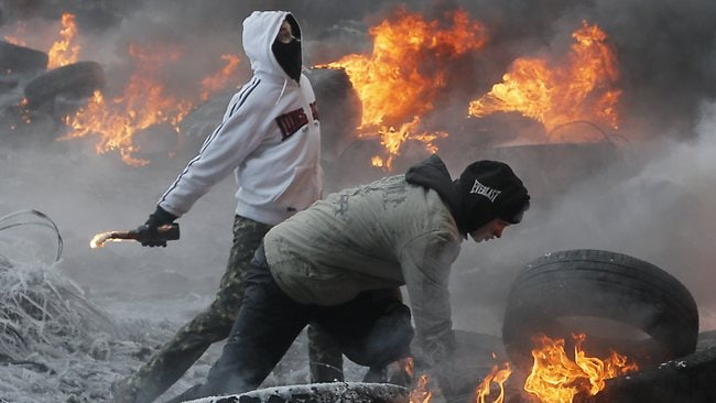 Kiev is burning ... Protesters throw molotov cocktails at riot police during a clash in central Kiev.
