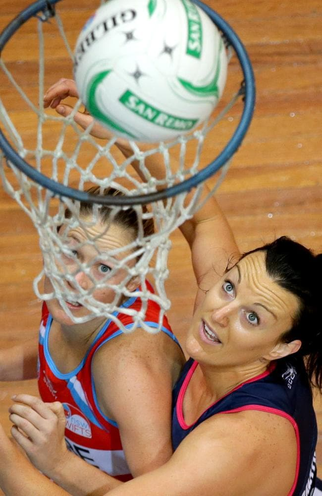 Bianca Chatfield puts pressure on the Sydney Swifts' Susan Pratley. Picture: Gregg Porteous
