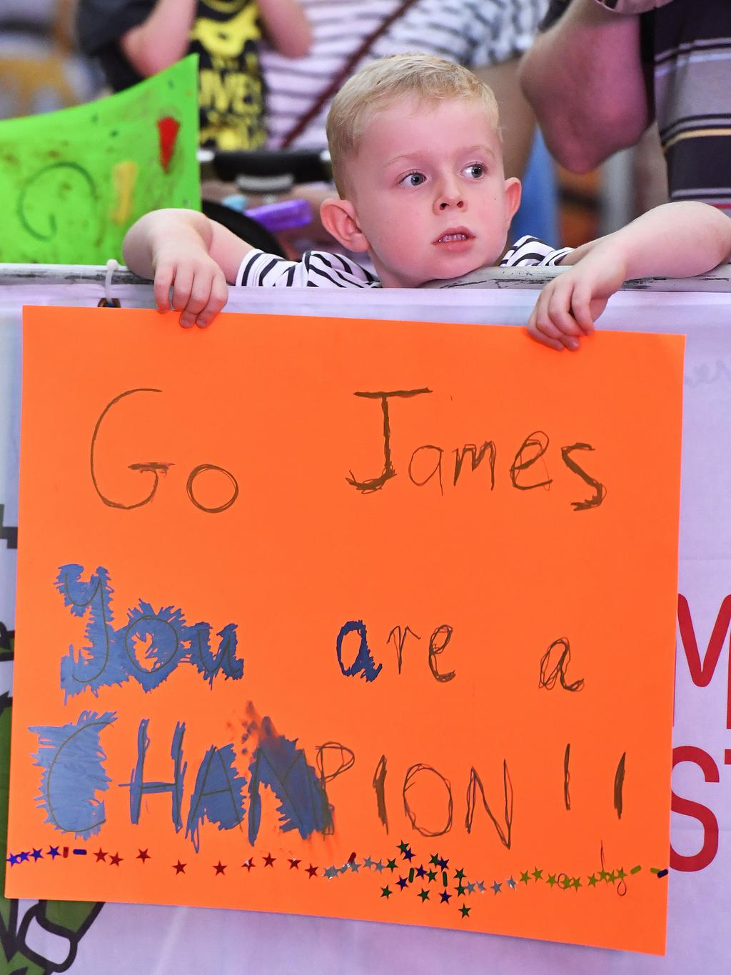 A young fan cheers during the Mitchell Street Mile.