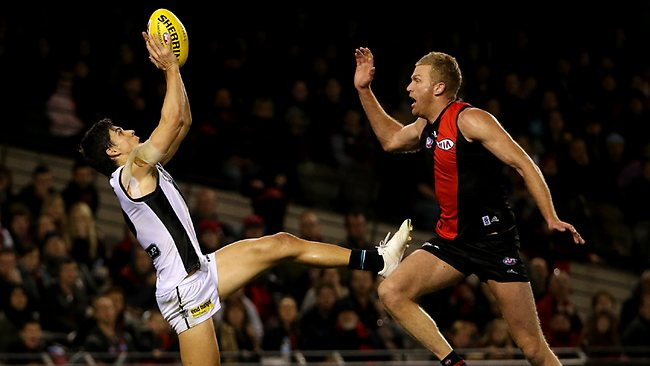 Port Adelaide forward Angus Monfries outmarks Dustin Fletcher. Picture: Colleen Petch
