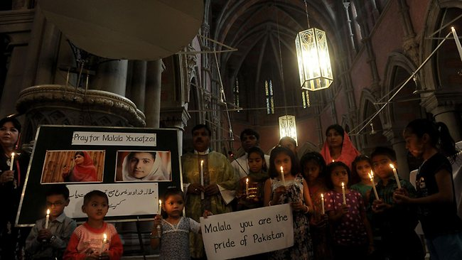 Pakistani Christians attend a mass praying for the recovery of child activist Malala Yousafzai at a church in Lahore. Picture: AFP / Arif Ali