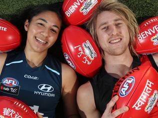 Dyson Heppell and Darcy Vescio with special footy