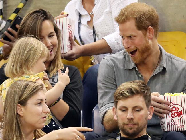 After realising this adorable child was blissfully chomping away on his popcorn, Harry fights back. Picture: Chris Jackson/Getty Images for the Invictus Games Foundation