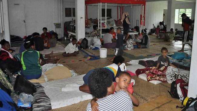 Residents take shelter at an evacuation centre during Tropical Cyclone Evan in Suva. Picture: AFP