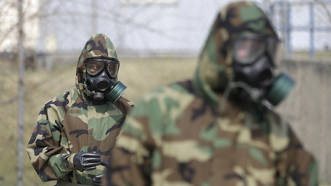 Soldiers of the U.S. Army 23rd chemical battalion wear gas masks while attending a demonstration of their equipment during a ceremony to recognize the battalion's official return to the 2nd Infantry Division based in South Korea at Camp Stanley in Uijeongbu, north of Seoul.