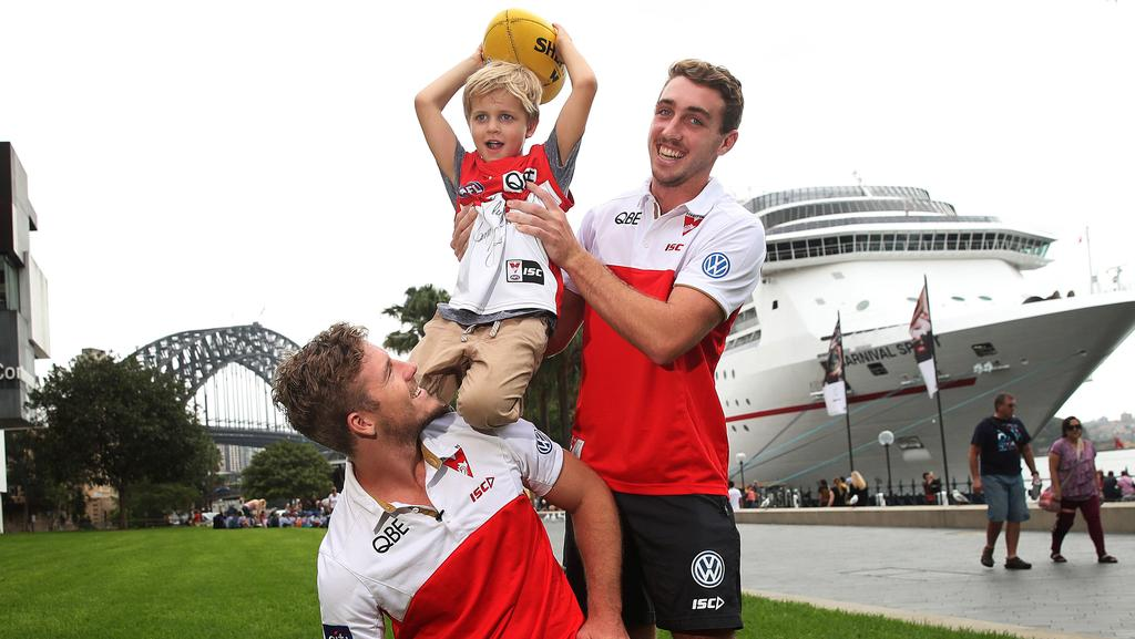Luke Parker and Daniel Robinson with six-year-old Buddy McLean. Picture: Phil Hillyard