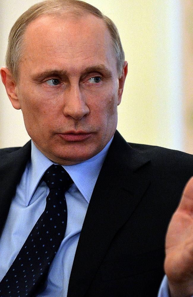 Business: Russian President Vladimir Putin addresses selected media at his country estate