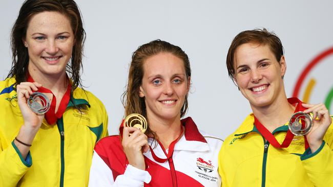 Gold medallist Francesca Halsall of England poses with silver medallist Cate Campbell and bronze medallist Bronte Campbell.