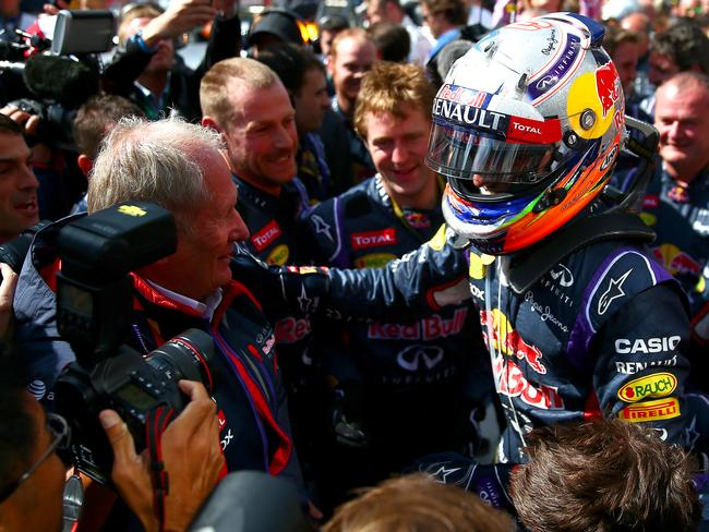 Ricciardo is swamped after the victory.