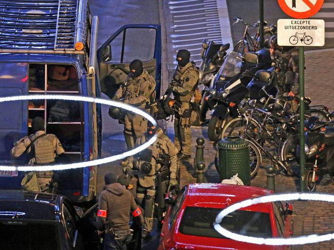 Terrorism searches ... armed special forces conduct search operations in the Antoine Dansaertstraat — Rue Antoine Dansaert street in Brussels on December 20, 2015. Picture: AFP/Belga/Nicolas Maeterlinck