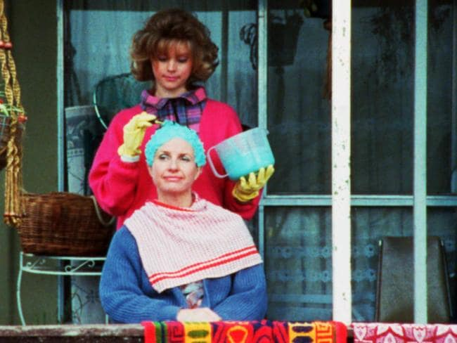 Sophie Lee, as Tracey Petropoulous, with her mum Sal, played by Anne Tenney, in a scene from The Castle.