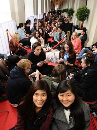 Amabel Lim and Angela Au arrived on Friday night to secure their spots at the front of the queue. Picture: Ellen Smith