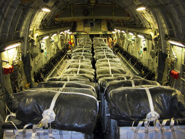Food drop ... Pallets of bottled water are loaded aboard a US air force aircraft in preparation for a humanitarian airdrop over Iraq.