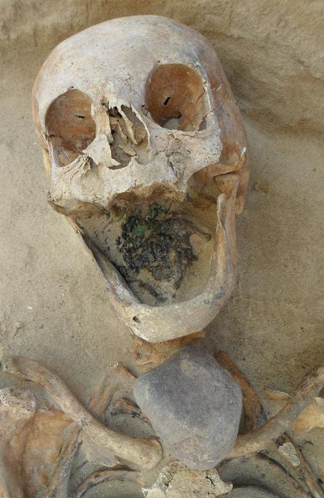 Victim of suspicion ... This skeleton of a woman, 45—49, had a large stone placed directly on top of the throat. Source: PLOS ONE