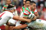 Adam Reynolds is tackled by the South Sydney defence.