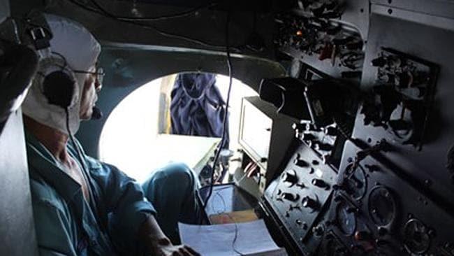A navigator on board a Vietnamese Air Force search and rescue mission. Picture: Thanh Nien