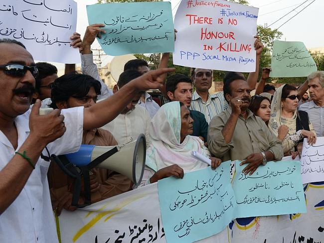 Condemnation ... Pakistani activists hold placards as they chant slogans during a protest