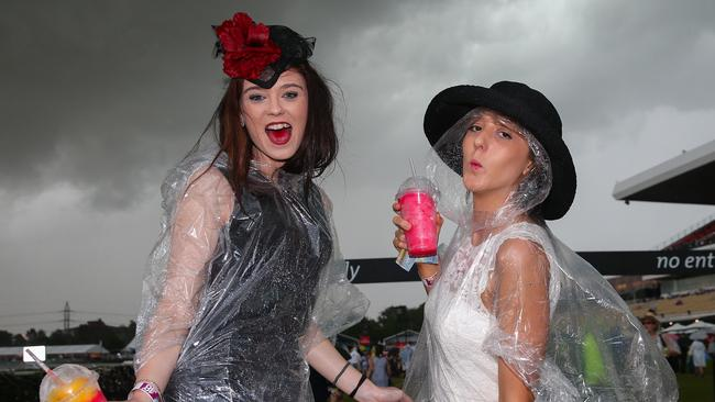 Dark skies ... racegoers Dana Tucek and Kaitlyn Fyfe don't let the clouds worry them. Picture:Ian Currie