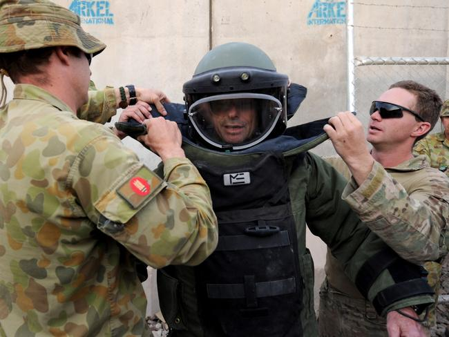 The Explosive Ordnance Disposal (EOD) Team assist Australian Federal Opposition Leader, the Honourable Tony Abbott donning the EOD suit during his tour of Multi National Base Tarin Kot, in Afghanistan. .