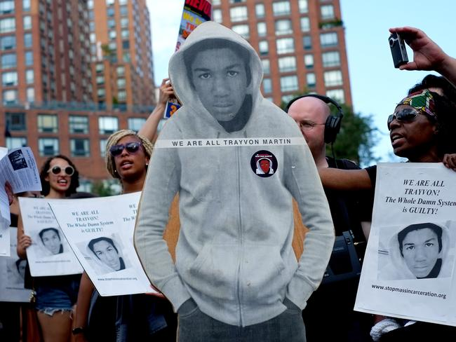 Activists on Union Square stand with a cut out photo of Trayvon Martin on July 14, 2013. AP Photo/Craig Ruttle
