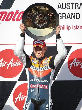 Casey Stoner celebrates after winner the 2012 Australian Moto GP. Picture: Jake Nowakowski