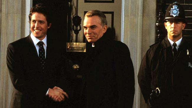 Hugh Grant with Billy Bob Thornton in Love Actually.