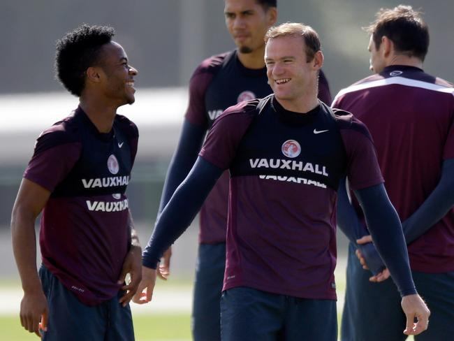 England players Wayne Rooney and Raheem Sterling.