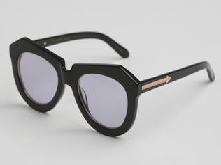 Black shades will lift when teamed with slashes of yellow and red. Karen Walker One Worship black frames, $349, David Jones