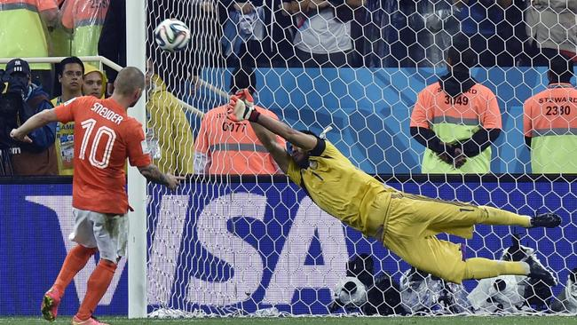 Argentina's goalkeeper Sergio Romero saves a penalty from Netherlands' Wesley Sneijder.