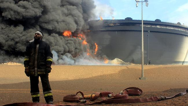 A Libyan oil facility was set ablaze last month after attacks launched by Islamic State militants to seize key export terminals. Picture: AFP