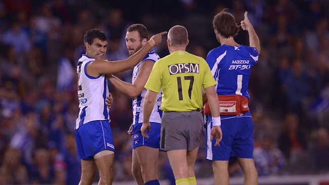 North Melbourne forward Lindsay Thomas has words with the umpire after an off-the-ball incident. Picture: Colleen Petch