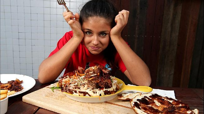 A 1.6kg, 9000kj Phat Bastard Burger challenge is underway at Surfers Paradise. Bulletin reporter Milena Stojceska took on the burger yesterday but failed. Pic: David Clark