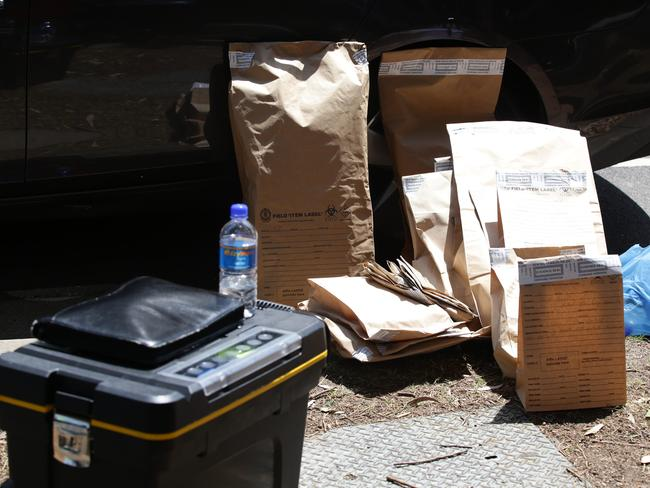 Items taken away in evidence bags during the raids. Picture: Craig Wilson