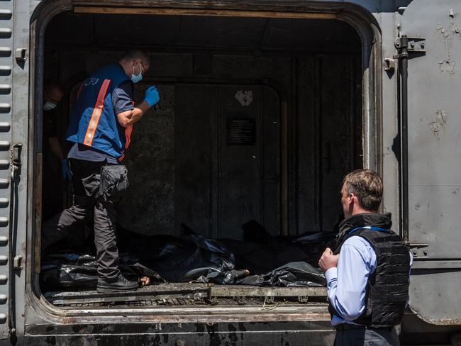 Alexander Hug (R), Deputy Chief Monitor of the Organisation for Security and Cooperation in Europe (OSCE) Special Monitoring Mission to Ukraine, visits a train containing the bodies of victims. Picture: Brendan Hoffman