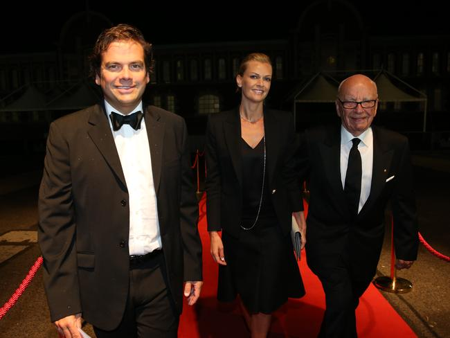Family tradition ... Lachlan Murdoch, his wife Sarah and Rupert Murdoch on the red carpet.