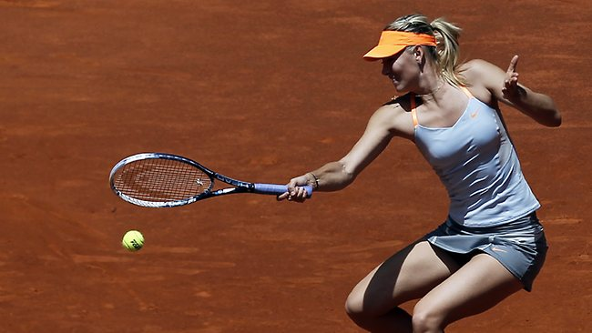 Maria Sharapova returns the ball against Alexandra Dulgheru at the Madrid Open. Picture: Andres Kudacki