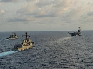 150510-N-TP834-044 SOUTH CHINA SEA (May 10, 2015) The aircraft carrier USS Carl Vinson (CVN 70), the guided-missile destroyer USS Gridley (DDG 101), the guided-missile cruiser USS Bunker Hill (CG 52), and Malaysian frigate KD Lekir (FSG 26) participate in a bi-lateral training exercise, aimed at developing and expanding bi-lateral exercises with the Malaysian Royal Navy. The Carl Vinson Strike Group is deployed to the U.S. 7th Fleet area of operations supporting security and stability in the Indo-Asia-Pacific region. (U.S. Navy photo by Mass Communication Specialist 2nd Class John Philip Wagner, Jr./Released)