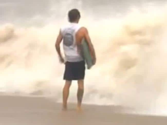 'Idiot' tries to surf mid-cyclone